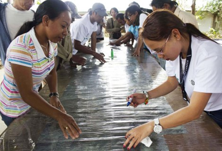 Participants map out the river and road networks with the tribal community in Miarayon