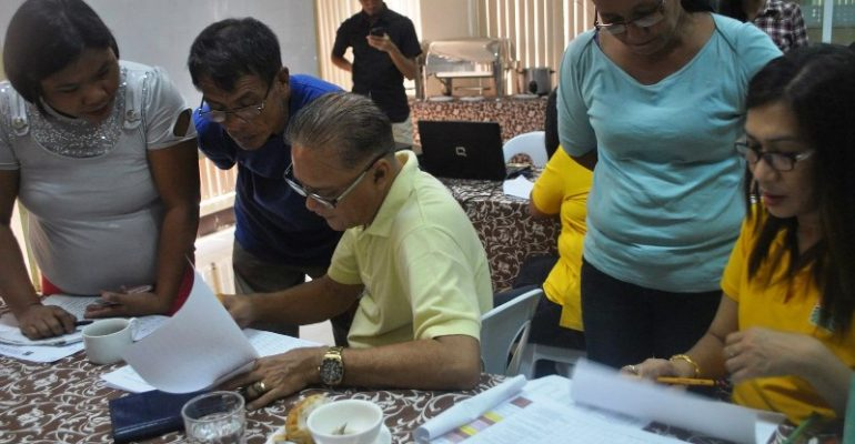 DAR Iloilo Municipal Agrarian Reform Program Officers (seated) mentor CARRD Paralegal Volunteers regarding status of their assigned landholdings. Photo by CARRD.