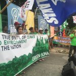 Jaybee Garganera of ATM leading the mobilization in front of the DENR Office. Photo by Denise Musni.
