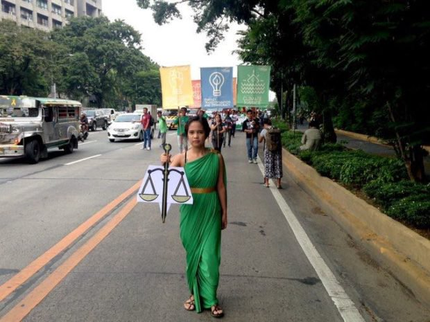 Lady-Justice-for-climate-justice-leading-the-rallyists-at-the-Quezon-City-Memorial-Circle.-Photo-by-Celine-Amilhamja.-620x465