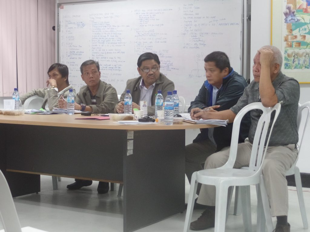 DAR Secretary Rafael Mariano (center) and Officials hearing the presentations of the farmers.